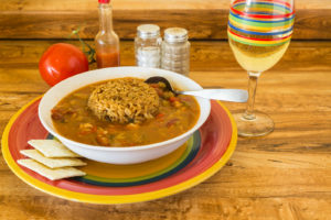 Dish of gumbo with dirty rice